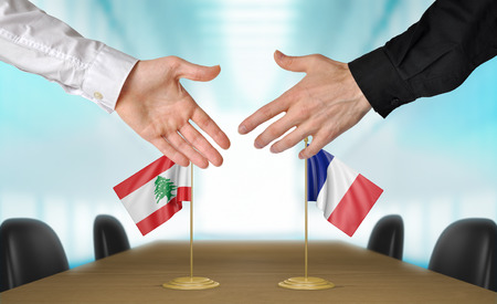 diplomats: Lebanon and France diplomats shaking hands to agree deal