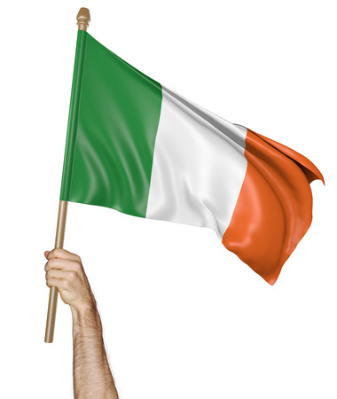 proudly: Hand proudly waving the national flag of Ireland