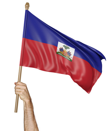 proudly: Hand proudly waving the national flag of Haiti Stock Photo