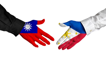 diplomacy: Taiwan and Philippines leaders shaking hands on a deal agreement
