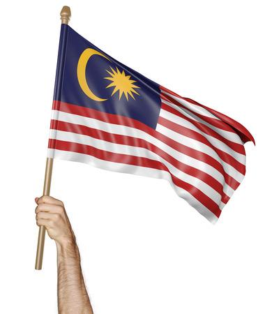 Hand trots zwaaiend met de nationale vlag van Maleisië