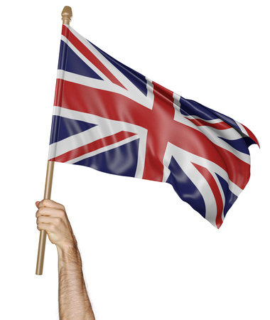 proudly: Hand proudly waving the national flag of United Kingdom Stock Photo
