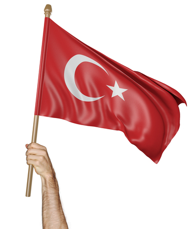 Hand proudly waving the national flag of Turkey