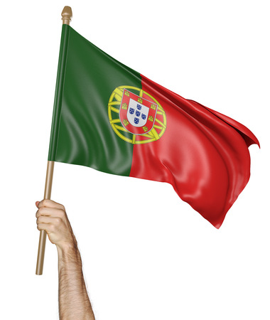 proudly: Hand proudly waving the national flag of Portugal