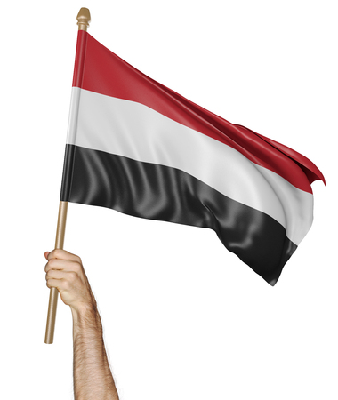 proudly: Hand proudly waving the national flag of Yemen