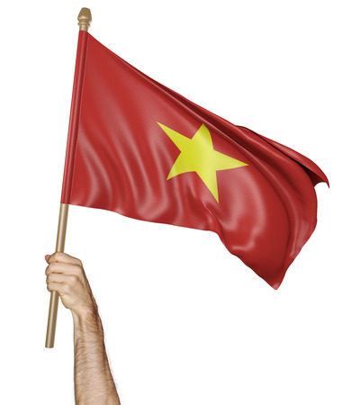 demonstrator: Hand proudly waving the national flag of Vietnam