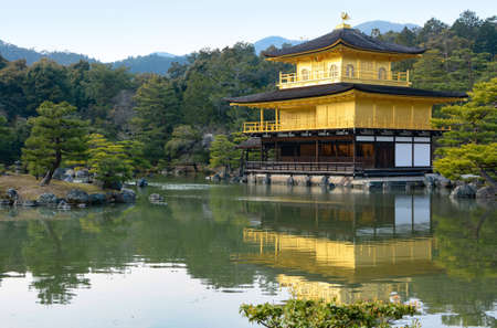 rokuonji: Kinkaku-ji Temple and its golden reflection in the surrounding pond garden in Kyoto, Japan Editorial
