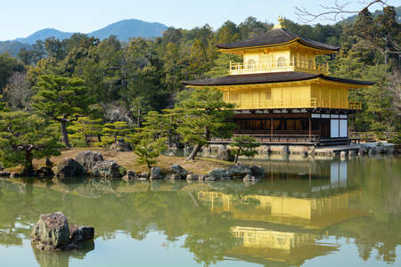rokuonji: Rokuon-ji Temple of the Golden Pavilion reflecting in the surrounding pond garden in Kyoto, Japan Editorial