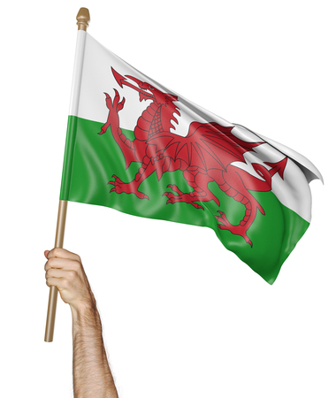 proudly: Hand proudly waving the flag of Wales, 3D rendering