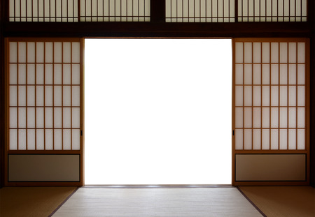 Traditional Japanese wood and rice paper doors and tatami mat flooring Stock Photo