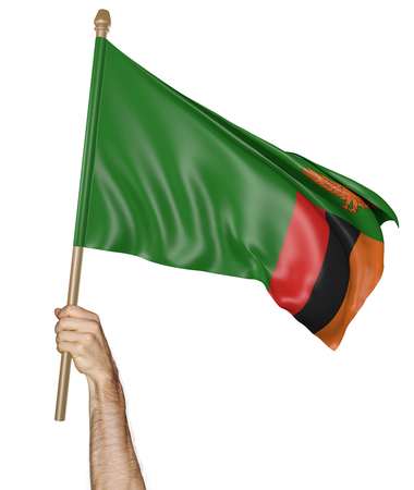 zambian: Hand proudly waving the national flag of Zambia, 3D rendering