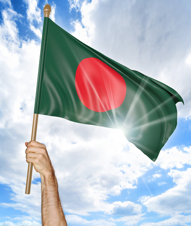 bangladesh 3d: Persons hand holding the Bangladesh national flag and waving it in the sky, 3D rendering