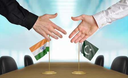 agree: India and Pakistan diplomats shaking hands to agree deal, part 3D rendering