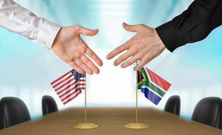 agree: United States and South Africa diplomats shaking hands to agree deal, part 3D rendering