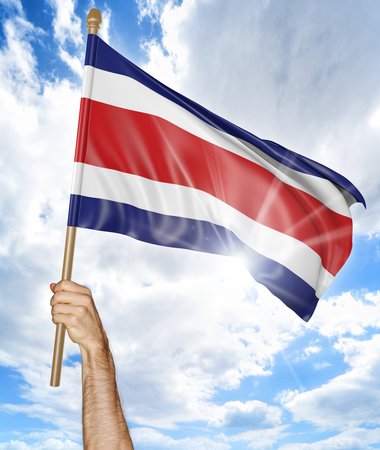costa rican flag: Persons hand holding the Costa Rican national flag and waving it in the sky, part 3D rendering