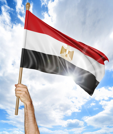 egypt revolution: Persons hand holding the Egyptian national flag and waving it in the sky, 3D rendering