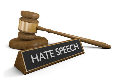 defamation: Court law justice symbols and a sign that says hate speech, 3D rendering