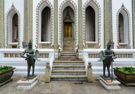 historical building: Tantima bird statues at Viharn Yod entrance at the historic Grand Palace in Bangkok, Thailand