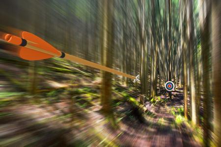 Arrow traveling through air at high speed to archery target with motion blur, part photo, part 3D rendering