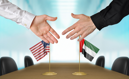 diplomats: United States and United Arab Emirates diplomats shaking hands to agree deal, part 3D rendering