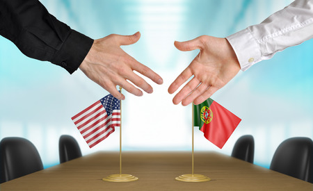 diplomats: United States and Portugal diplomats shaking hands to agree deal, part 3D rendering
