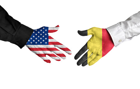 treaty: United States and Belgium leaders shaking hands on a deal agreement Stock Photo
