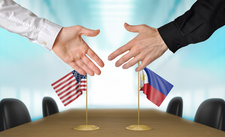diplomats: United States and Philippines diplomats shaking hands to agree deal, part 3D rendering Stock Photo