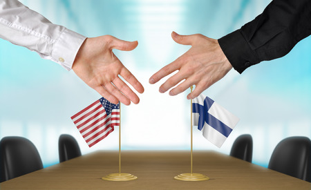 diplomats: United States and Finland diplomats shaking hands to agree deal, part 3D rendering Stock Photo
