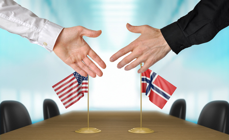 agree: United States and Norway diplomats shaking hands to agree deal, part 3D rendering Foto de archivo