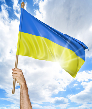 activism: Persons hand holding the Ukrainian national flag and waving it in the sky, 3D rendering