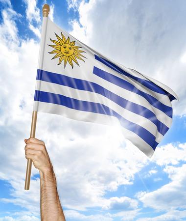 bandera de uruguay: Mano de la persona que sostiene la bandera nacional uruguaya y que lo agita en el cielo, 3D