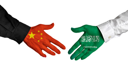 China and Saudi Arabia leaders shaking hands on a deal agreement Stock Photo