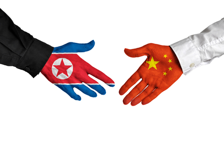 north korea: North Korea and China leaders shaking hands on a deal agreement Stock Photo