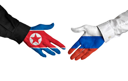 foreign national: North Korea and Russia leaders shaking hands on a deal agreement Stock Photo