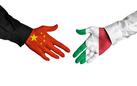 China and Italy leaders shaking hands on a deal agreement Stock Photo