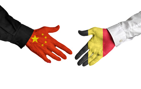 treaty: China and Belgium leaders shaking hands on a deal agreement