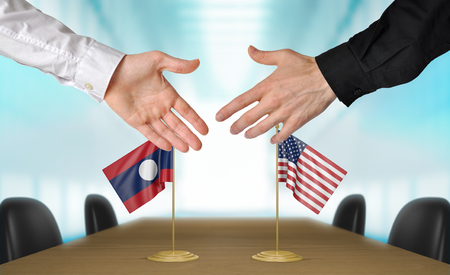 diplomats: Laos and United States diplomats shaking hands to agree deal, part 3D rendering
