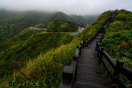 jiufen: Boardwalk on a mountain ridge in Jiufen, Taiwan along the coast of the Yinyang sea Stock Photo