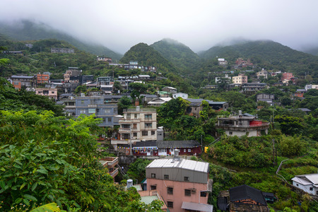 rural community: Houses in a small hillside village in the misty mountains of Jiufen, Taiwan Stock Photo