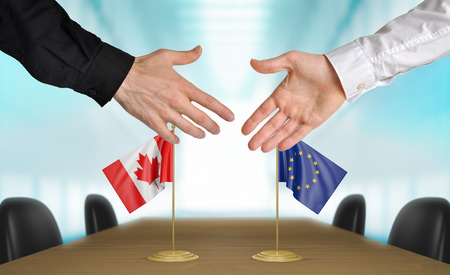 diplomats: Canada and European Union diplomats shaking hands to agree deal, part 3D rendering Stock Photo