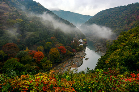 Mist rolling over the Katsura River in the Arashiyama area of Kyoto, Japan in autumn