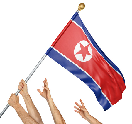 Team of peoples hands raising the North Korea national flag, 3D rendering isolated on white background Stock Photo