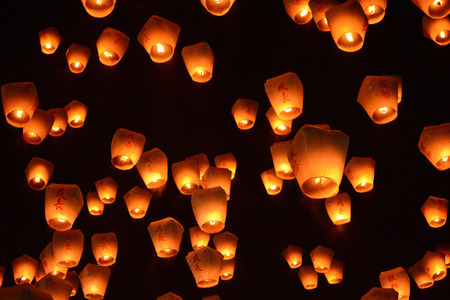 Thousands of lanterns fill the sky at the 2017 Pingxi Sky Lantern Festival in Taiwan, the Chinese text on them says chengzhang, which means to grow Banco de Imagens