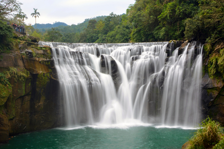 currents: Long exposure of Shifen Waterfall on the Keelung River in Pingxi District, New Taipei City, Taiwan