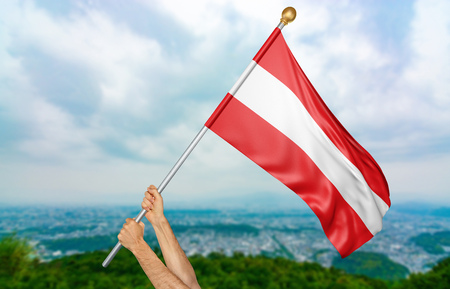 Young mans hands proudly waving the Austria national flag in the sky, part 3D rendering