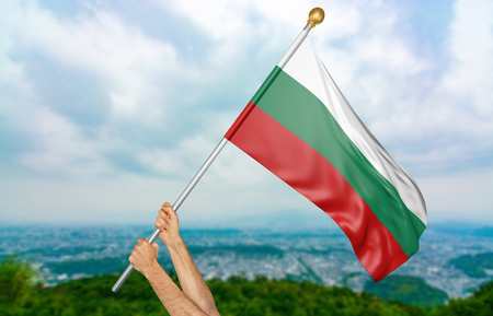Young mans hands proudly waving the Bulgaria national flag in the sky, part 3D rendering