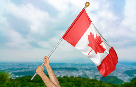 Young mans hands proudly waving the Canada national flag in the sky, part 3D rendering