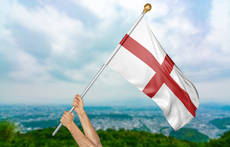 Young mans hands proudly waving the England national flag in the sky, part 3D rendering