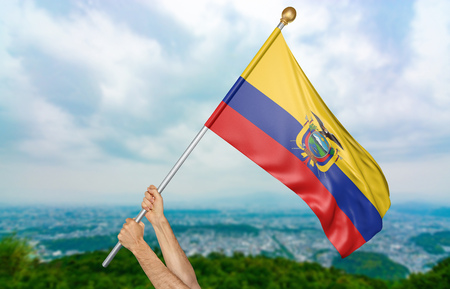 Young man's hands proudly waving the Ecuador national flag in the sky, part 3D rendering Stockfoto