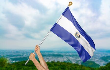 bandera de el salvador: Manos del joven que agitan orgulloso la bandera nacional de El Salvador en el cielo, parte que rinde 3D Foto de archivo